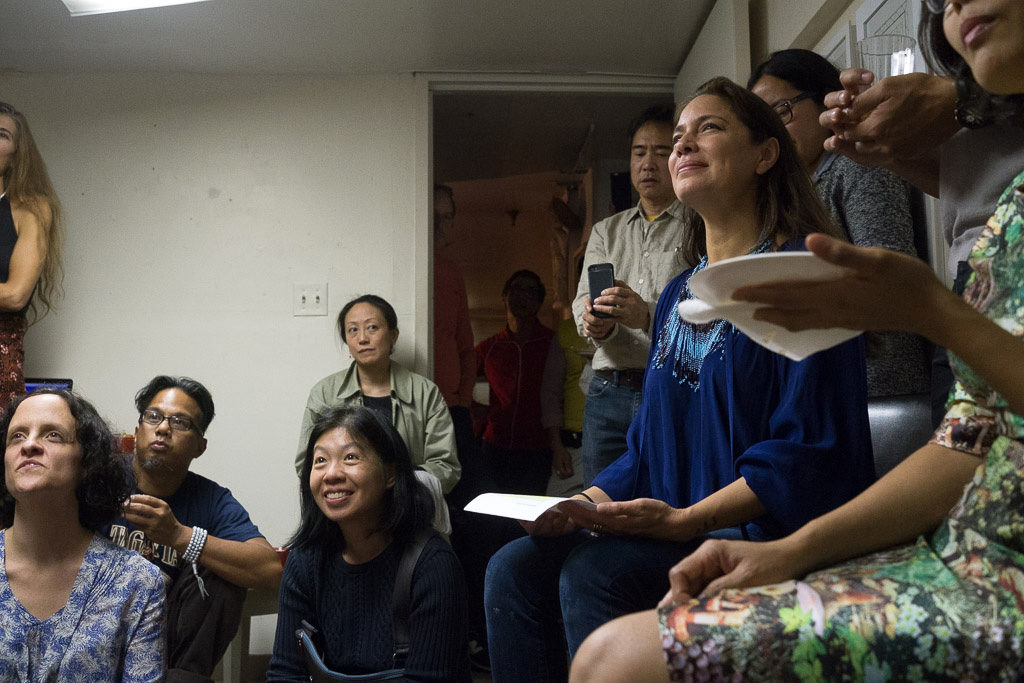 "The crowd listens to Bing's reading of ""Kalipay."""